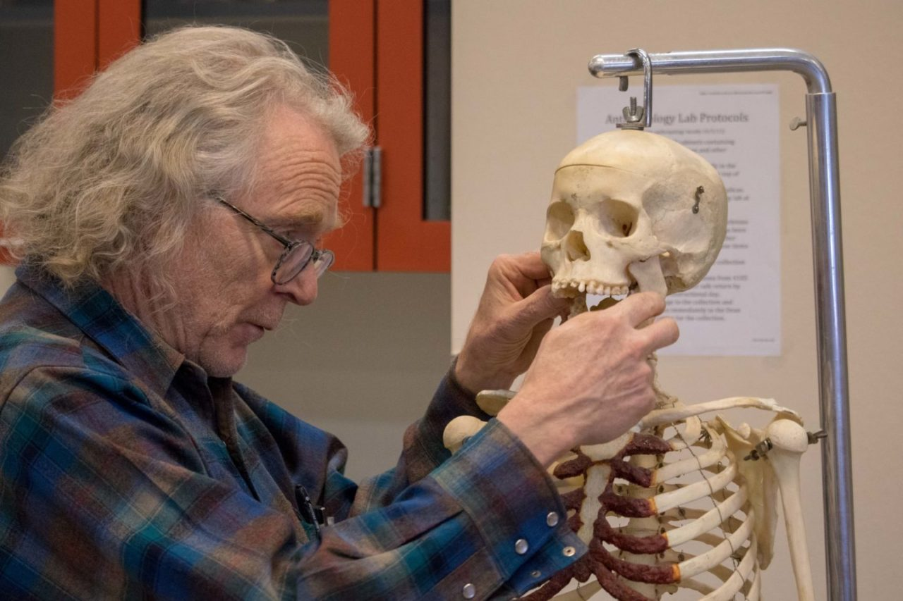Anthropologist with Skull