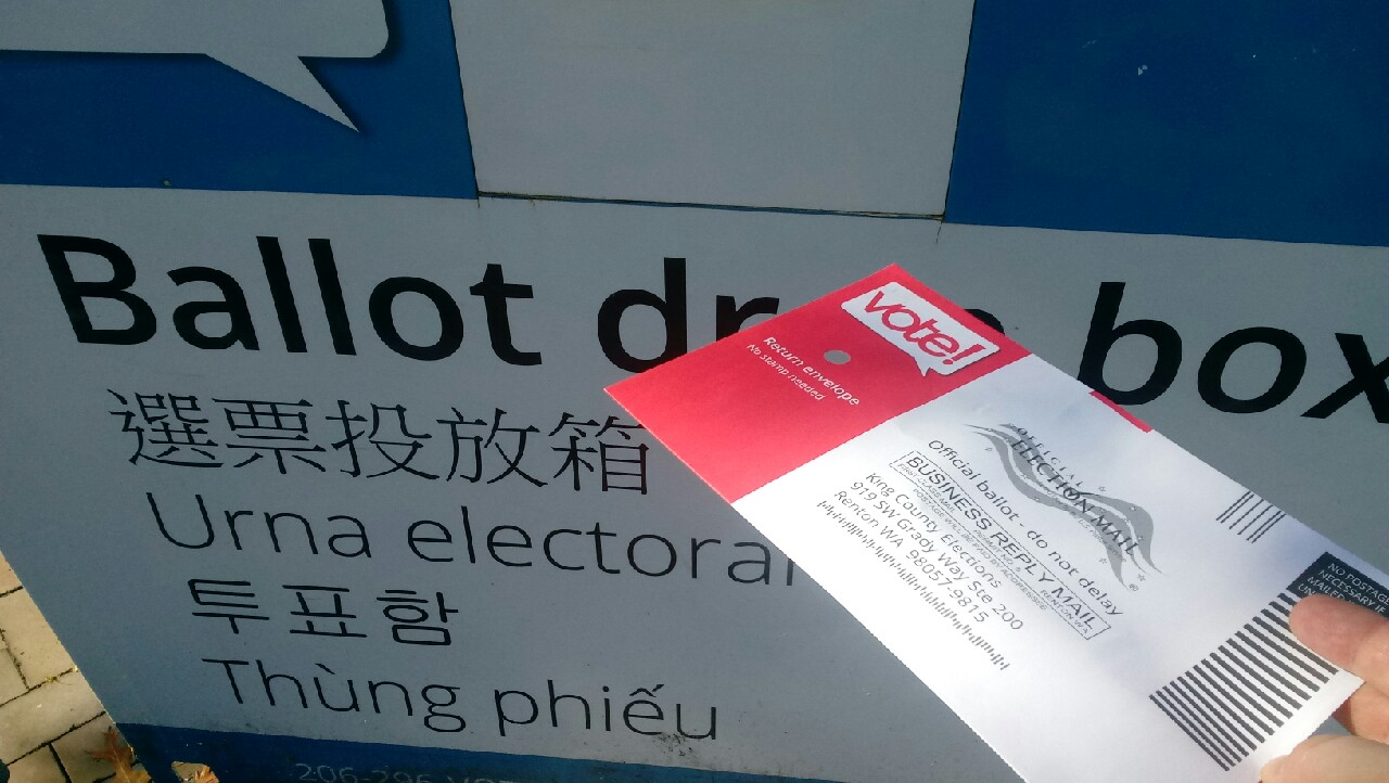 Ballot being put in drop box outside SCC campus