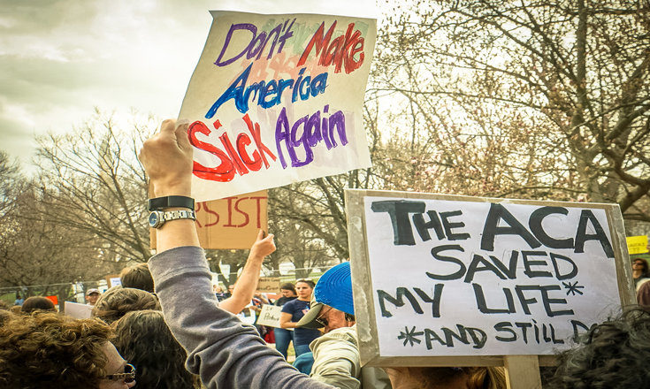 "protest signage ""don't make america sick again"" and ""the ACA saved my life"""