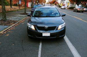 Front view of car parked in bike lane