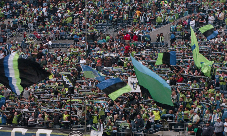 The Emerald City Supporters group cheer on the Sounders during their September 17 game against DC United.