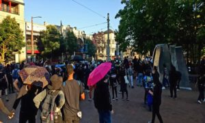 Protestors gather en masse on Seattle Central's South Plaza to protest police brutality