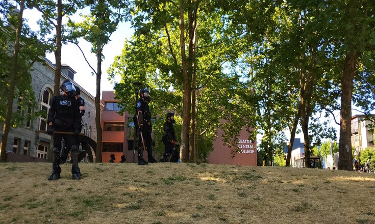 Seattle police patrolling the South Lawn of Seattle Central College