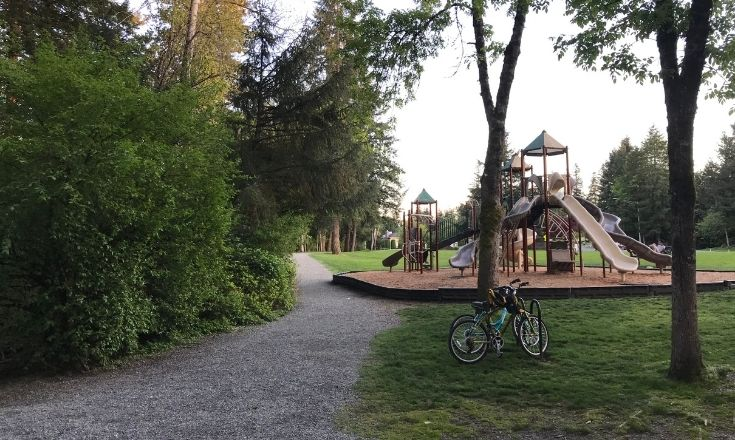 The trail connects to a playground
