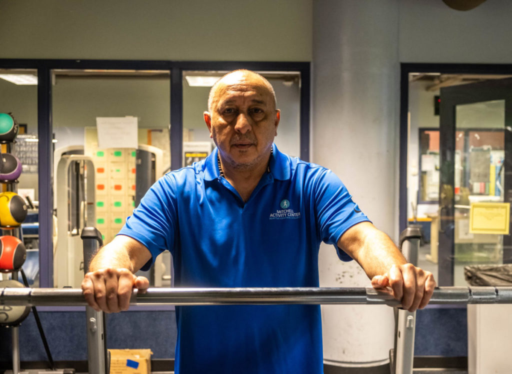 Hernandez poses in front of the weight room at the MAC