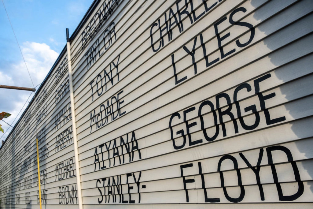 The names of victims of hate crime and police brutality span across the side of the Royal Room's wall in Seattle's Columbia City.