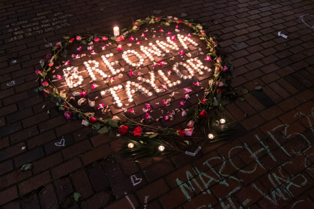 One year after Breonna Taylor's murder, protestors took to the streets to decry her tragic death, lighting a vigil in Occidental Park before their march.