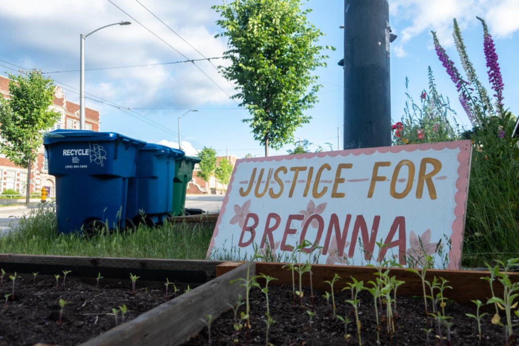 """A """"Justice For Breonna"""" sign sits propped up against a telephone pole in front of a residence in Seattle's Central District, honoring the life of Breonna Taylor, who was shot and killed in her own home by police officers during a botched raid."""